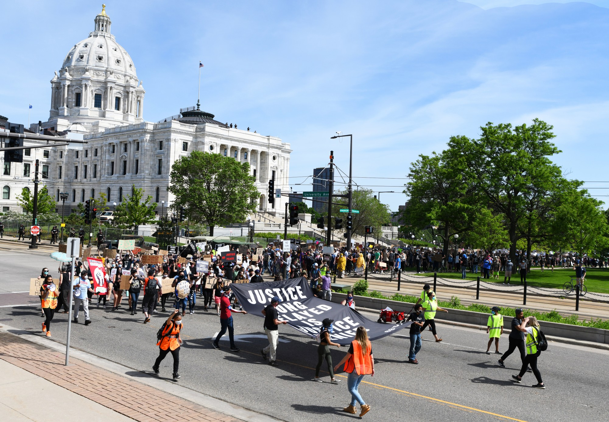 Demonstrators march past the Minnesota State Capitol on Sunday, May 31.
