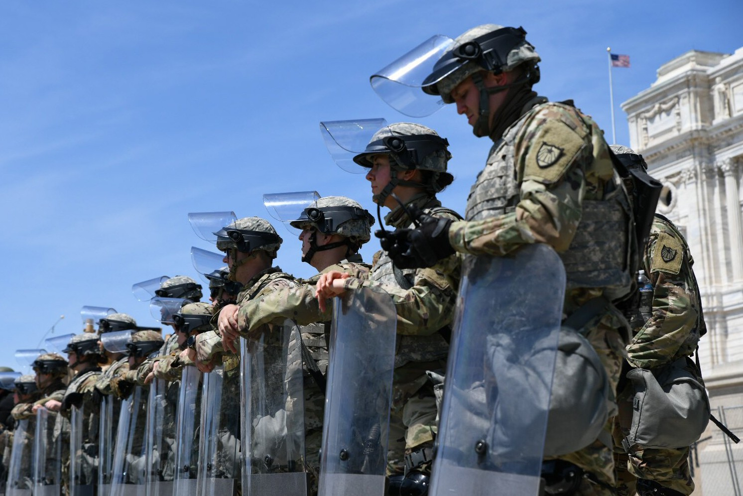 National Guard soldiers with riot shields form a line in front of the Minnesota State Capitol on Sunday, May 31.