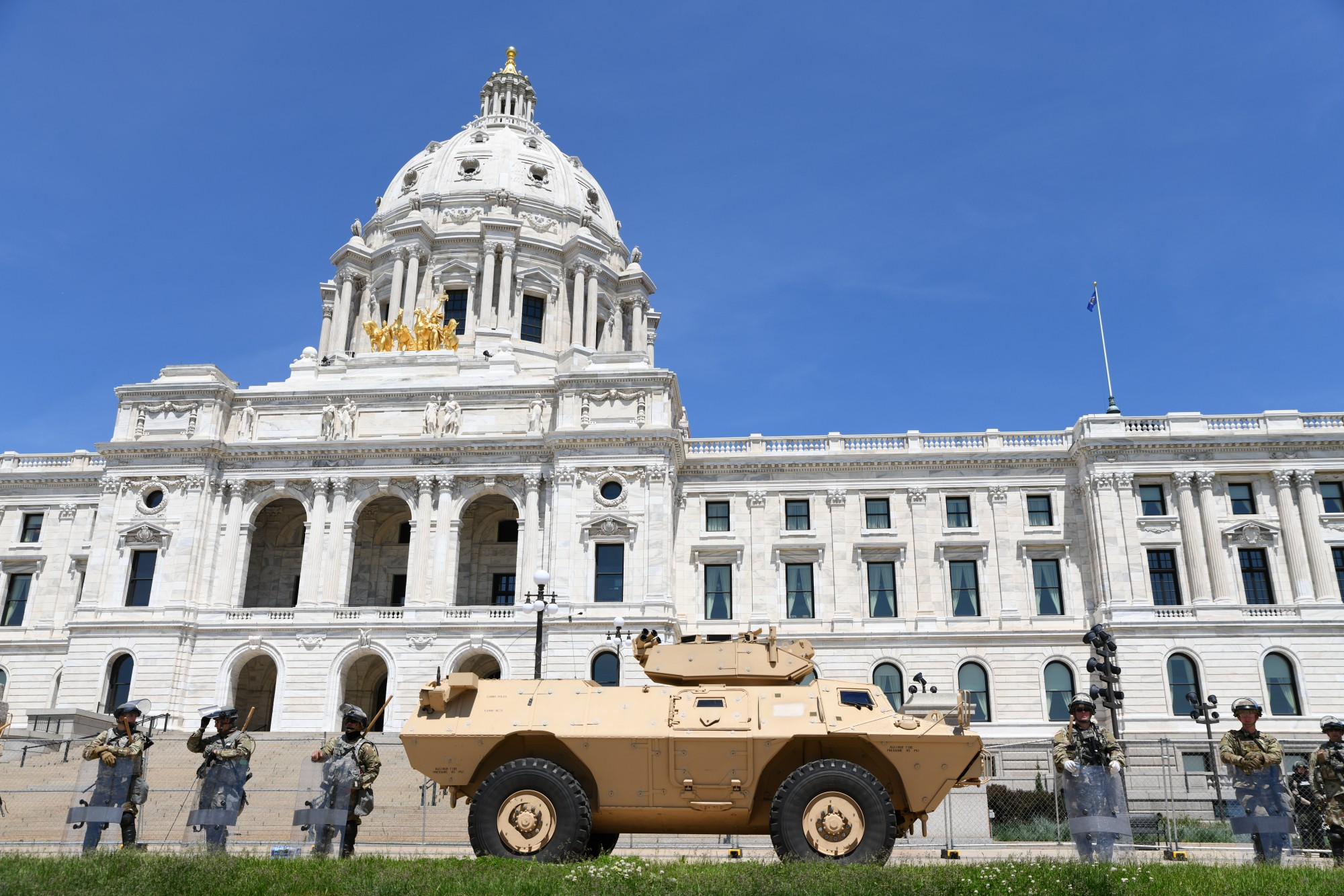 One of several National Guard armored security vehicles forms part of the perimeter held by National Guard and law enforcement around the Minnesota State Capitol on Sunday, May 31.