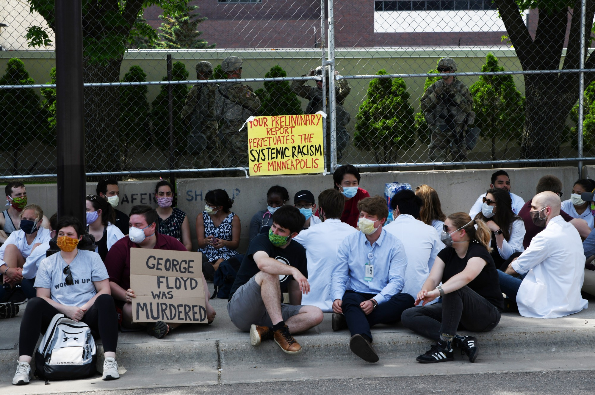 University of Minnesota medical students protest outside of the Hennepin County Medical Examiner's office on Tuesday, June 2.