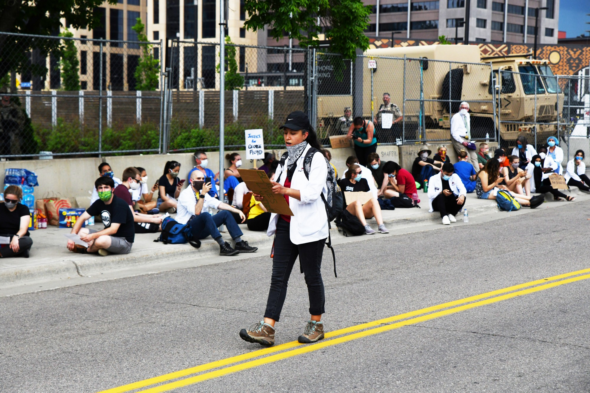 University of Minnesota medical student Edith Hernandez reads the criminal complaint against Derek Chauvin aloud to assembled medical students and professionals in front of the Hennepin County Medical Examiner's office on Tuesday, June 2.