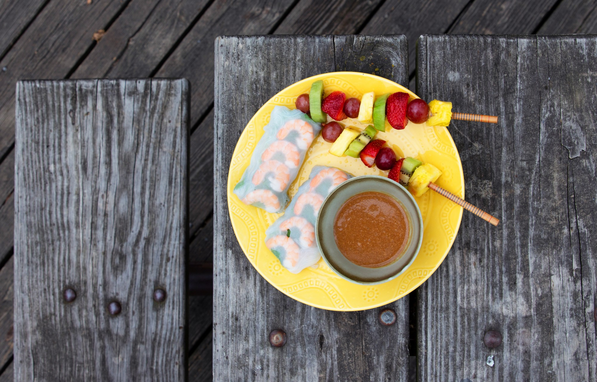 <p>A picnic plate of fruit kebabs and shrimp spring rolls in Nicollet Island Pavilion on Tuesday, June 9. (Audrey Rauth / Minnesota Daily)</p>