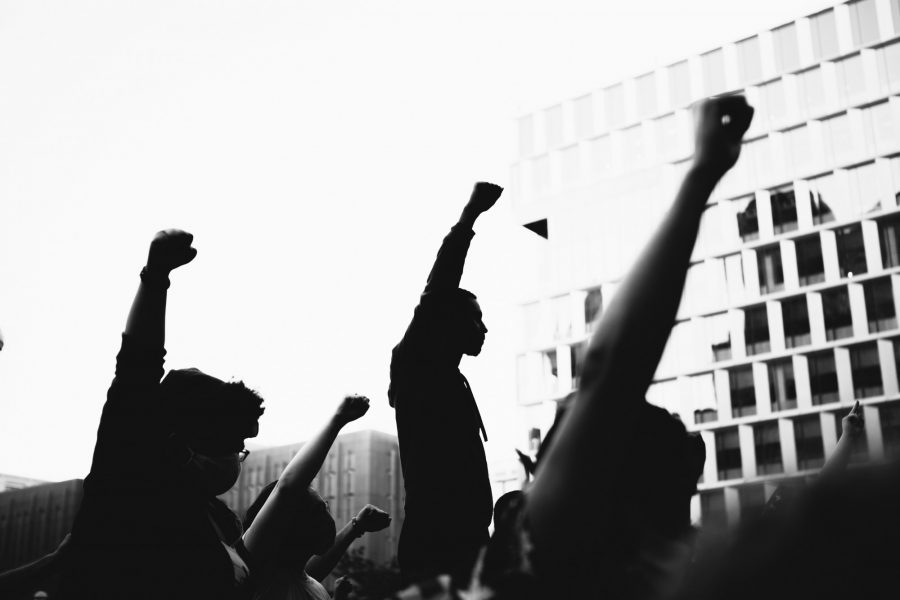Protesters+demonstrate+the+Black+power+fist+as+a+sign+of+solidarity+with+the+Black+Lives+Matter+movement%2C+photographed+by+Isaiah+Rustad.+%28Image+courtesy+of+Isaiah+Rustad%29%0A