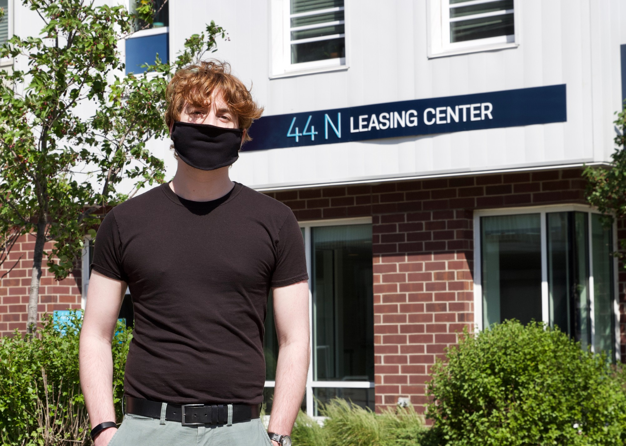 <p>Mark Eckelaert stands in front of 44 North, the apartment building he is residing in, Wednesday, June 17 in Stadium Village. Eckelaert is searching for a short-term lease or sublease to take over for the fall semester.</p>