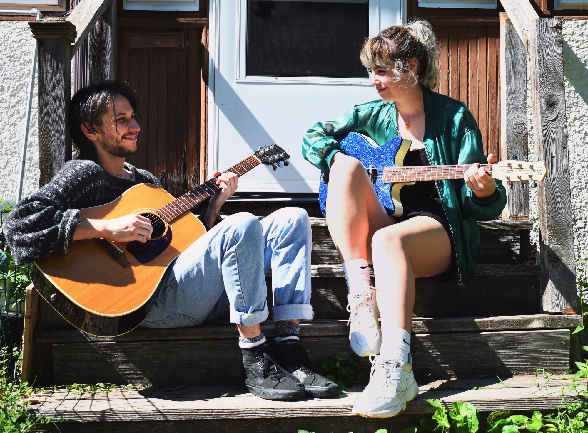 Dad Bod band members Callie Marino and Wilson Zellar sitting outside of their recording space on Saturday, June 20. Their EP Precursor will be released on July 10.