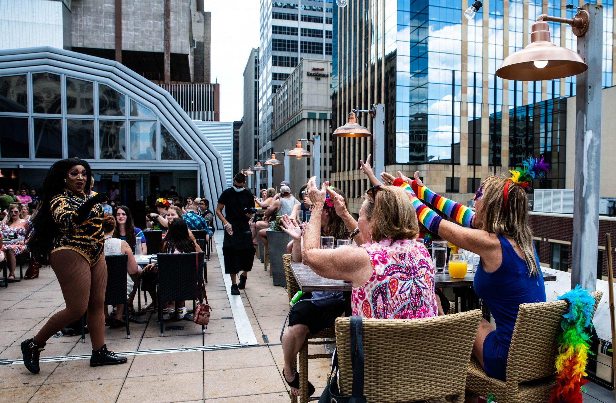 """Lori Kate, far right, cheers for Drag Brunch host Sasha Cassadine while sitting next to her mother Jeanette June, and friends Kirsten Gronstal and Sara Hadley, at the Pride Drag Brunch at Union Rooftop on Saturday, June 27. """"It's my first time out [since quarantine began],"""" said June, """"If I was going to come out, it would be for something like this."""""""