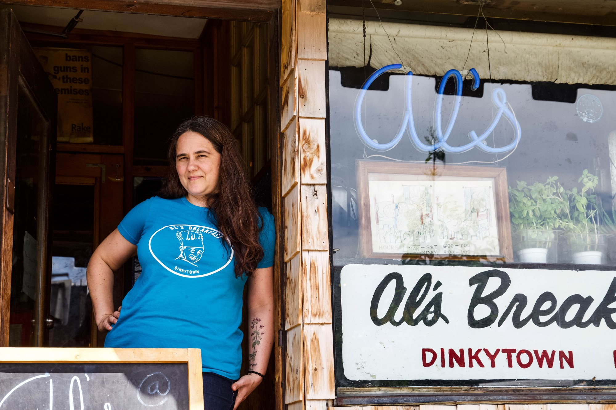 Alison Kirwin, owner of Al's Breakfast, poses for a portrait in front of the restaurant in Dinkytown on Wednesday, July 1.