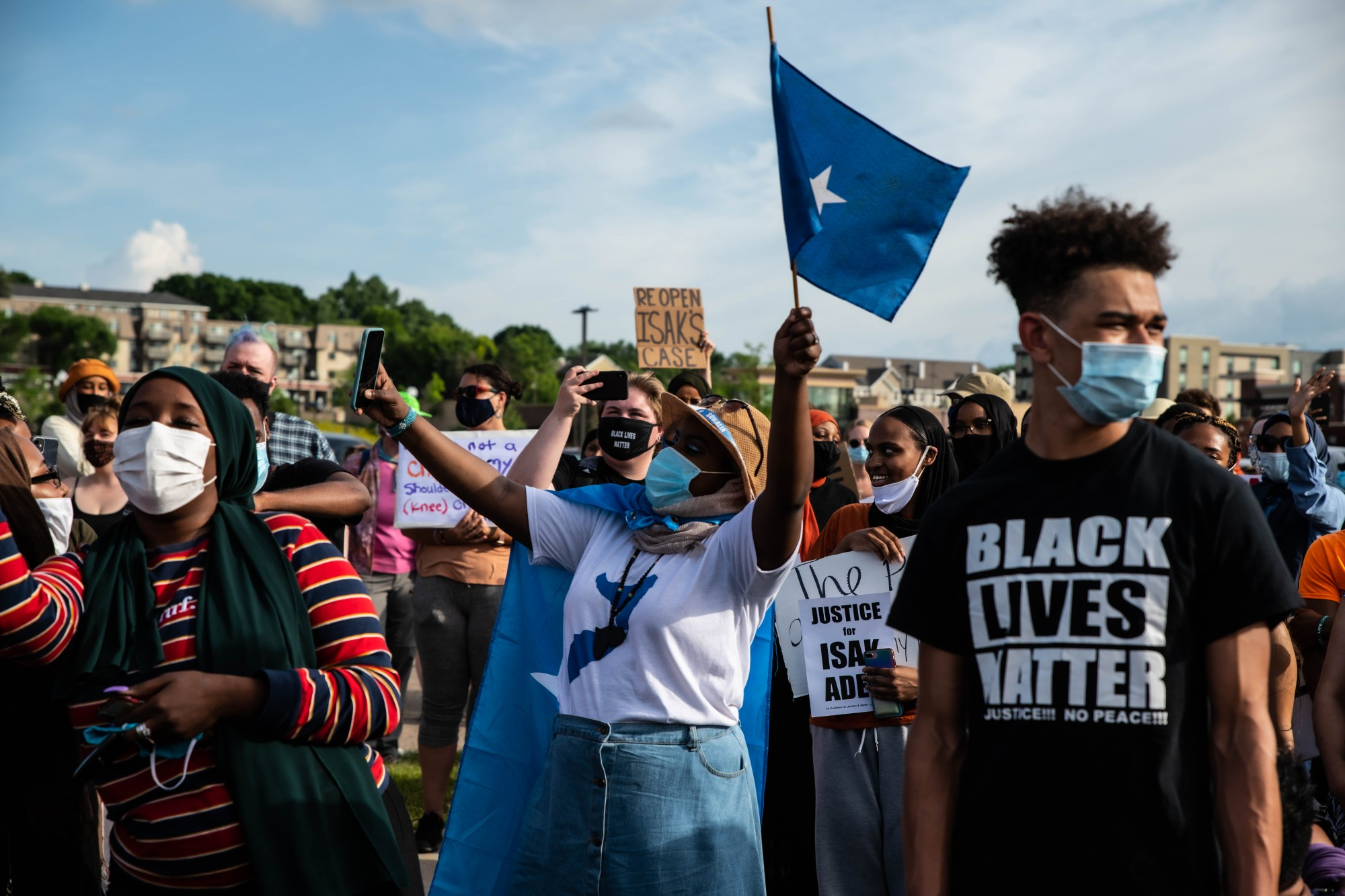 Protesters sing along with the Somali national anthem before marching along Highway 13 to the parking lot where police killed 23-year-old Isak Aden in July of 2019 in Eagan on Wednesday, July 1.