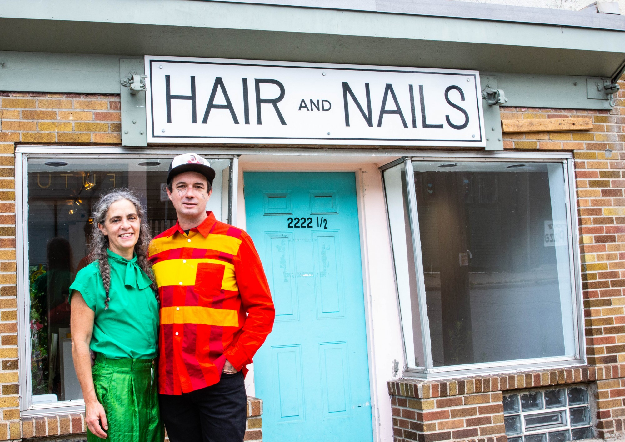<p>Kristin Van Loon, left, and Ryan Fontaine, owners and operators of Hair + Nails Contemporary Art Gallery, pose for a portrait in front of the gallery in Minneapolis on Monday, July 20. The gallery, located on East 35th St., has a new exhibit about queer love opening on Saturday, July 25.</p>