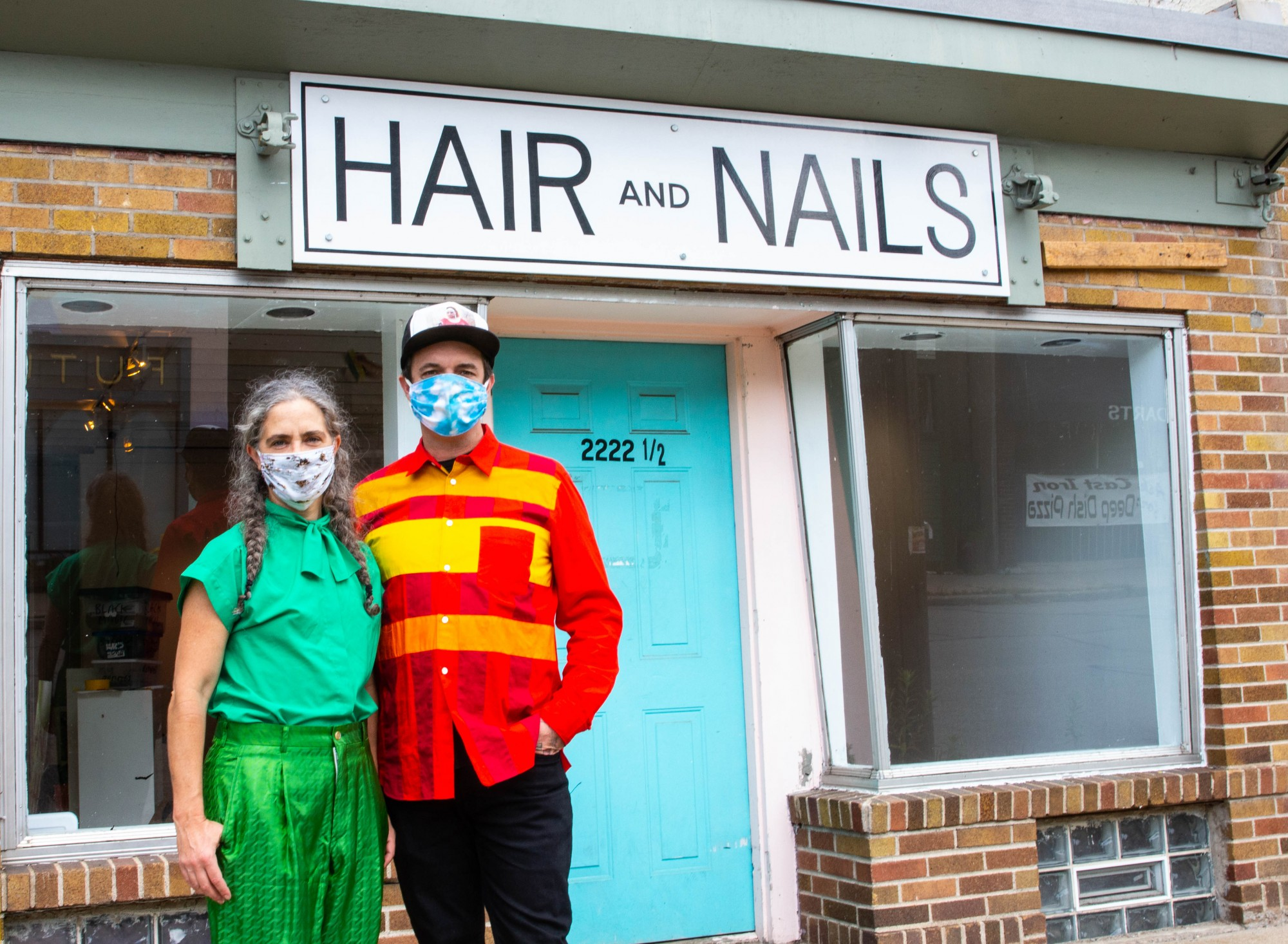 Hair + Nails Contemporary Art Gallery, located on East 35th St., has a new exhibit about queer love opening on Saturday, July 25. Kristin Van Loon (left) and Ryan Fontaine (right), who own and operate the gallery, pose for a portrait on Monday, July 20, 2020.