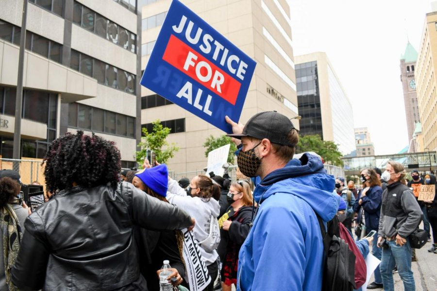 Protesters gather outside of the Hennepin County Family Justice Center in response to motions made by the police officers involved in George Floyd's murder on Friday, Sep. 11.  The four former officers filed motions to be tried separately.