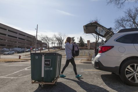 <p>Freshman Marissa Mazzetta loads her belongings in preparation for her return to Illinois with her father, Jim Mazzetta, at Middlebrook Hall on Saturday, March 21. Mazzetta, like many freshmen at the University of Minnesota, moved out of University housing as a result of COVID-19.</p>