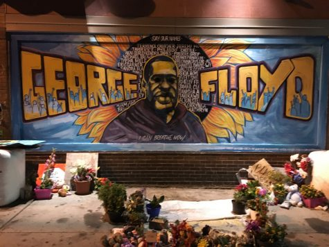 <p>George Floyd's mural on the corner of 38 Street and Chicago Avenue after being vandalized on Tuesday evening. </p>