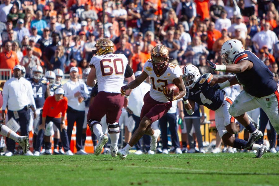 Gophers Wide Receiver Rashod Bateman carries the ball at the 2020 Outback Bowl on Wednesday, Jan. 1.  The Gophers went on to take the game 31-24 over the Auburn Tigers.