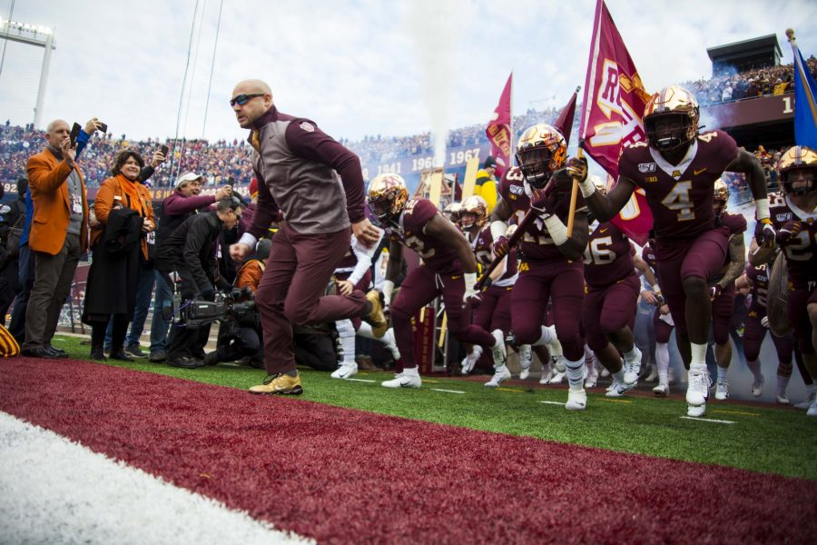 Head+Coach+PJ+Fleck+leads+the+team+out+of+the+tunnel+at+TCF+Bank+Stadium+on+Saturday%2C+Nov.+9.+The+Gophers+defeated+Penn+State+31-26+to+bring+their+record+to+9-0.+A+first+since+1904.+