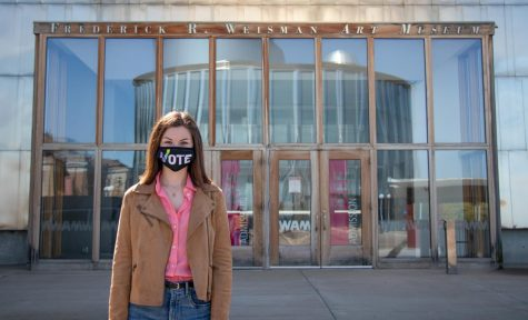 Sophomore Rose Lloyd-Slifkin, who studies political science and gender, women and sexuality studies, poses in front of the Weisman Art Museum on Thursday, Sept. 24. The Weisman is one of the voting locations available to students who are living on campus in dorms.