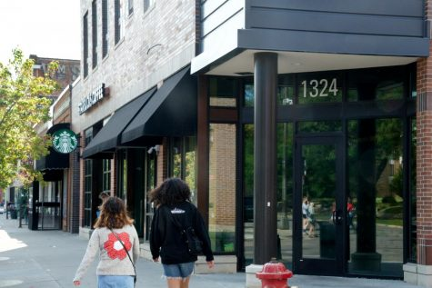 Pedestrians stroll past the empty storefront that previously housed the Gina + Will store in Dinkytown on Saturday, Sept. 5.