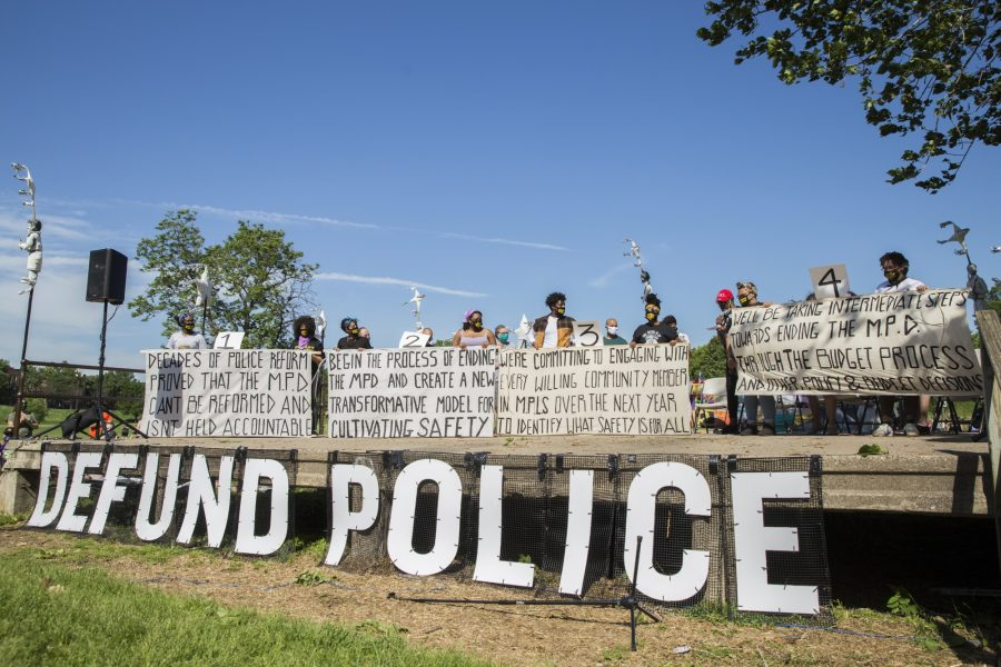 Nine Minneapolis City Council members declared their commitment to defunding and dismantling the Minneapolis Police Department alongside community groups Black Visions and Reclaim The Block to a vast crowd at Powderhorn Park on Sunday afternoon, June 7, 2020. (Photo courtesy of Liam James Doyle for MPR News)