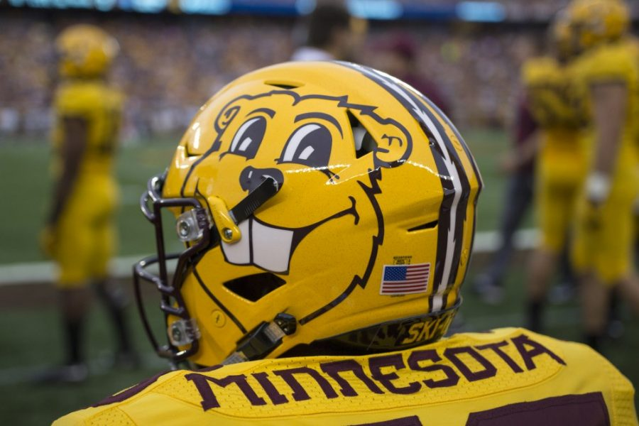 A Gophers football player watches from the sidelines during a game on Sept. 16, 2017.