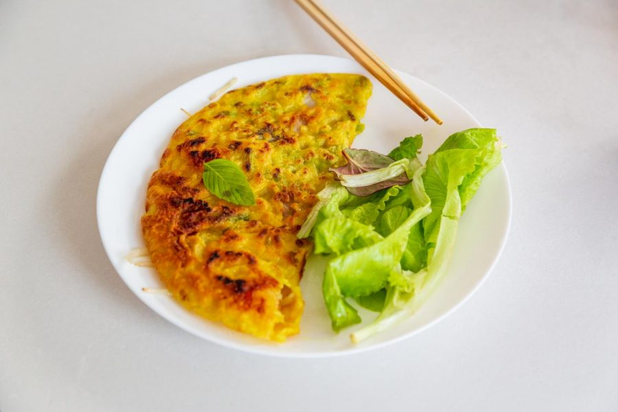 Bánh xèo is a crêpe style dish originating in Vietnam. Students prepare the traditional plate with rice flour, water and turmeric, along with a dipping sauce, Nước mắm/chấm then adding various proteins, spices, and vegetables on Sunday Sep 13.