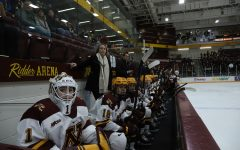 Members of the Gophers women's hockey team watch play from the bench at Ridder Arena on Friday, Feb. 28. The Gophers scored two power-play goals on the way to a 4-2 victory over St. Cloud State. (Jasmin Kemp / Minnesota Daily)