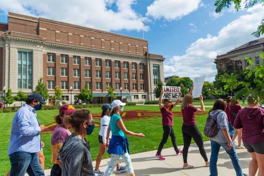 Protestors march past Northrup in protest of the potential cancellation of several men's sports programs on Wednesday, Sep. 16. The protest march began in Athlete's Village and ended in front of Morrill Hall, near President Joan Gabel's office.