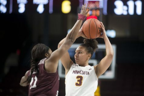 Forward Destiny Pitts looks to pass the ball through a defender at Williams Arena on Tuesday, Nov. 5, 2019. The Gophers fell to Missouri State 69-77.