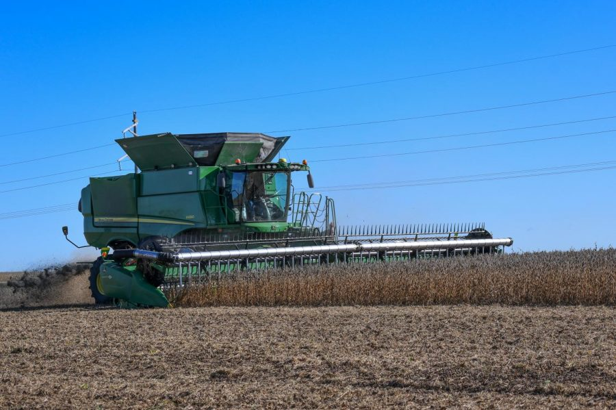 A combine harvests crops in Madison Lake on Wednesday, Sep. 30. University researchers are conducting research on alternative methods for applying fertilizers to crops in response to new challenges presented by climate change.