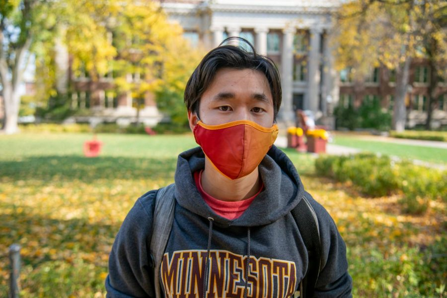 Junior Kyle Wong poses for a portrait on Sunday, Oct. 11 in front of Northrop Auditorium.