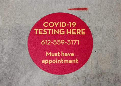 A ground sticker located in front of Boynton Health's COVID-19 testing center on Wednesday, Sep. 16. The testing facility is a small tent located outside the main entrance of Boynton.