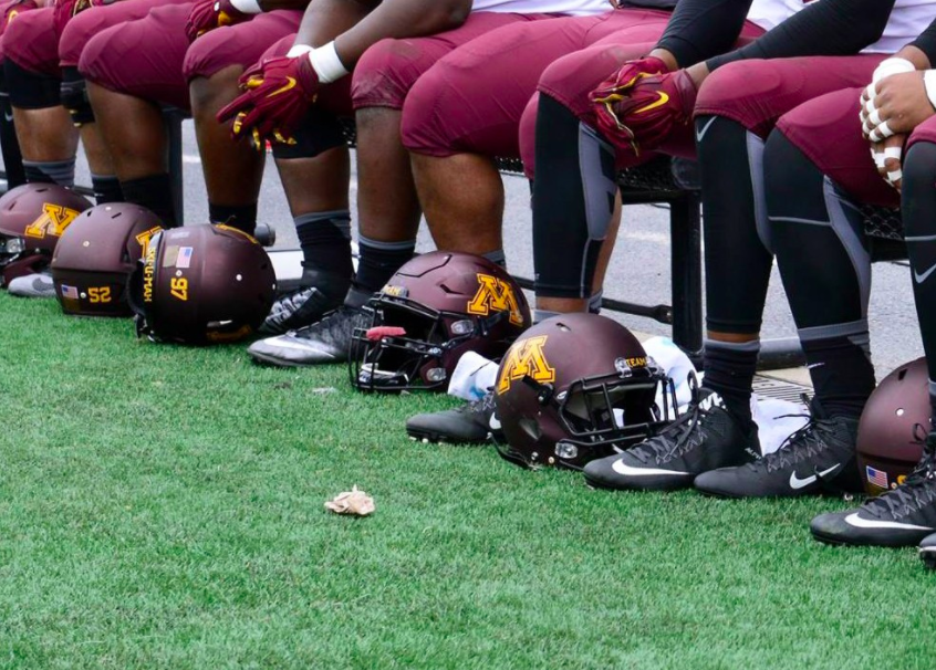 Gophers+football+players+sit+on+the+sidelines+during+a+game+at+TCF+Bank+Stadium+on+Oct.+3%2C+2015.