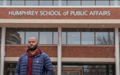 Njoya Chomilo poses for a portrait in front of the Humphrey School of Public Affairs on Sunday, Oct. 25. Chomilo, in his final year of graduate school, is one of the leaders of a petition to remove Mike Freeman from the Humphrey School of Public Affairs Dean's Advisory Council.