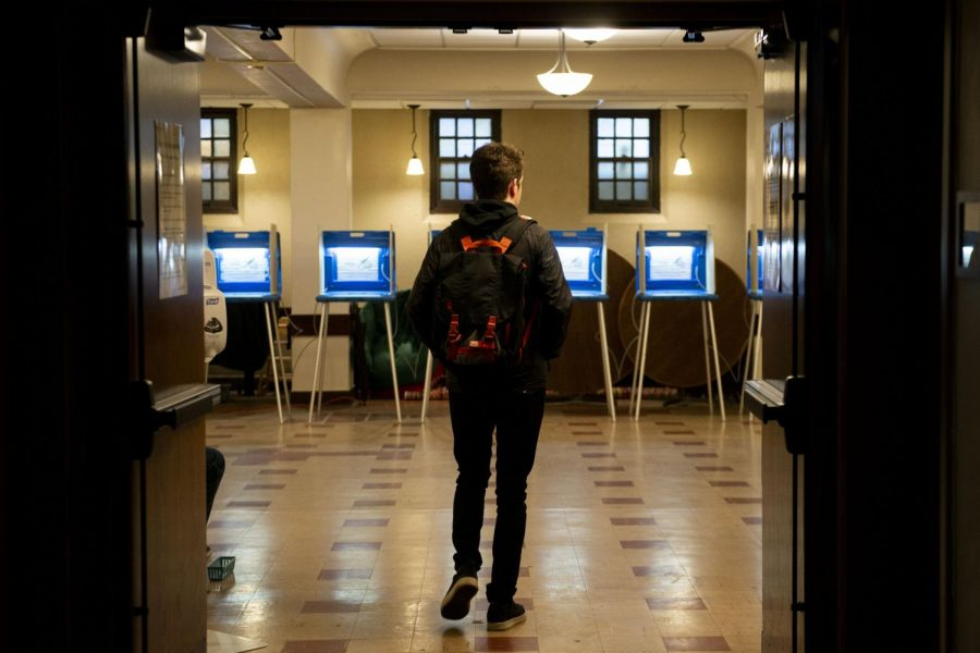 A voter enters the polling place at the Grace University Lutheran Church early in the morning on Tuesday, March 3.