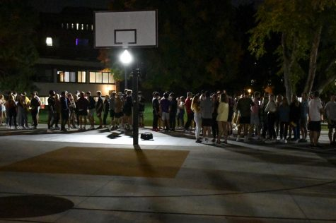 Students, many without masks and not following social distancing guidelines, gather to socialize in the Superblock plaza on Friday, Sep. 25. UMPD and Community Advisors sent the students back into their dorms before the 9 p.m. curfew.