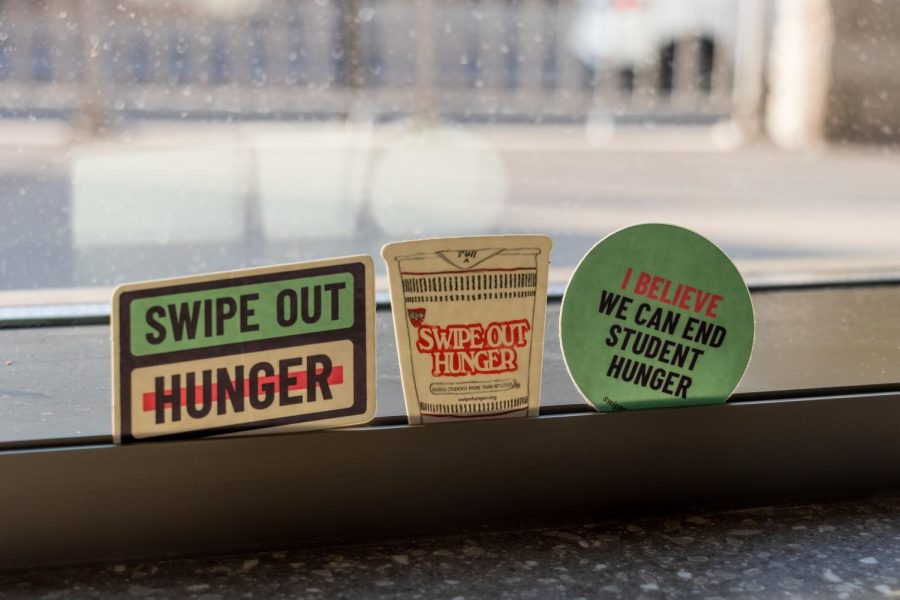 Stickers made for Swipe Out Hunger are displayed at the 17th Avenue Residence Hall on Friday, Oct. 9. Swipe Out Hunger is a program at the University of Minnesota where students with meal plans can donate unused meal swipes to help classmates who may not have enough.