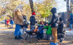Participants in an after school program congregate around a fire at Luxton Park on Tuesday, Oct. 27th. The program was created to raise money for additional teachers and increase social time for students who's education has gone completely virtual.