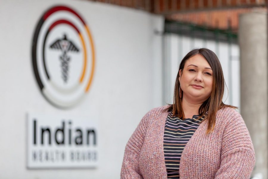Delilah Robb, a community health educator for the Indian Health Board of Minneapolis, poses for a portrait outside one of the organization's clinics. Robb's work provides a variety of educational experiences on the topic of sexual health for the American Indian community in the clinic's service area. As a member of the Turtle Mountain Band of Chippewa Indians, Robb has spent the entirety of her career working with the American Indian community and is currently a full-time first year student at the University's School of Public Health, studying Maternal and Child Health.