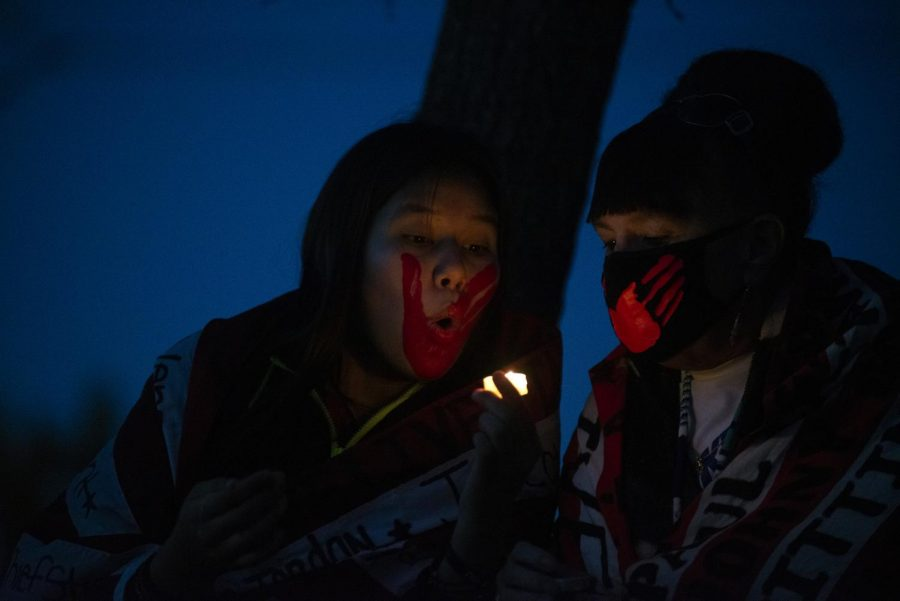 Organizers blow their candle after the vigil for missing and murdered Indigenous women and girls and other lives lost to police and gang violence and authority negligence at Boom Island Park in Minneapolis on Monday, Oct. 12. The crowd went on to march after the vigil.