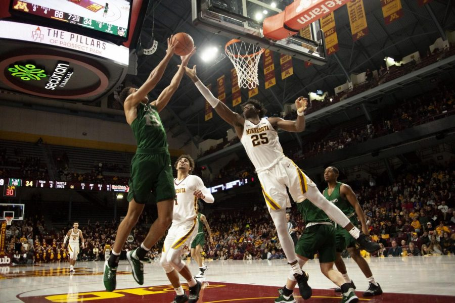 Center Daniel Oturu leaps to block an opponent at Williams Arena on Tuesday, Nov. 5. The Gophers went on to defeat Cleveland State 85-50.