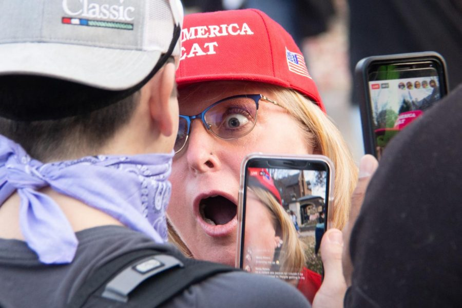 A+protester+wearing+a+%22Make+America+Great%22+cap+engages+in+a+verbal+altercation+with+a+counter-protester+at+an+event+outside+the+Minnesota+Governor+Tim+Walz%27s+residence+on+Saturday%2C+Nov.+7.