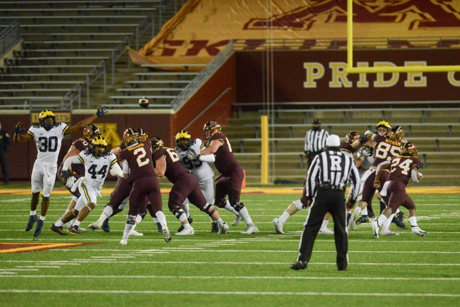 Gophers quarterback Tanner Morgan launches a pass over Michigan's defensive line on Saturday, Oct. 24.