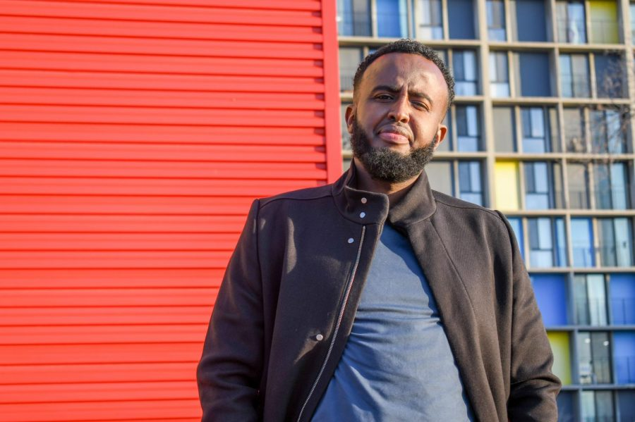 Project coordinator Abdurrahman Mahmud poses for a portrait outside of Mixed Blood theater on Monday, Nov. 16. The theater is holding a new program to open the discussion about reproductive education, substance abuse and mental health within Somali and East African communities.