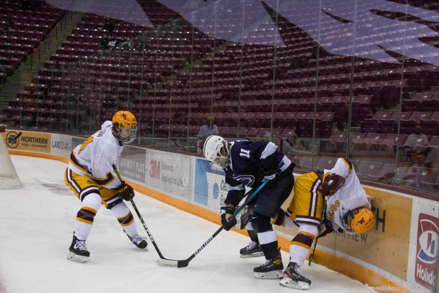Gophers+forward+Jaxon+Nelson+fights+for+possession+against+Penn+State+at+the+3M+Arena+at+Mariucci+on+Thursday%2C+Nov.+19.