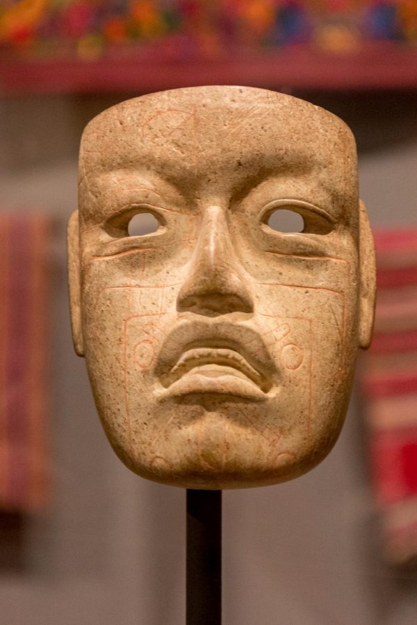 Display of an Olmec mask surrounded by Mayan textiles on the wall behind it at the Minneapolis Instute of Art on Saturday, Nov. 14. The mask was made between 900 and 300 B.C. and is believed to have been used in ceremonies.