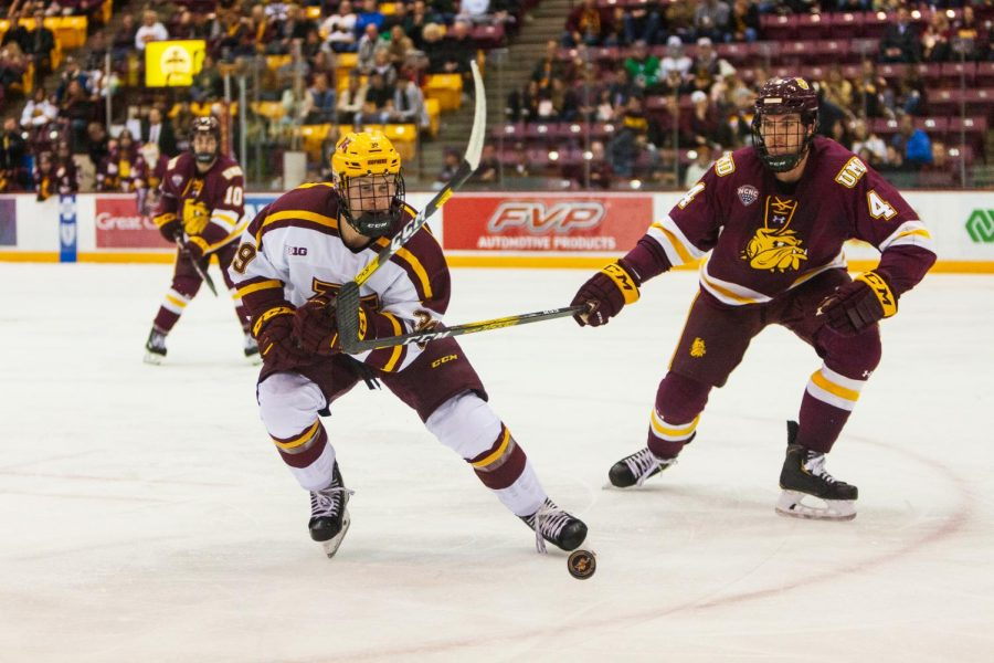 Gophers Forward Ben Meyers chases the puck in the 3M Arena on Friday, Oct. 25.  The Gophers went on to lose 2-5 to the University of Minnesota - Duluth.