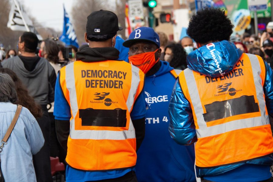 "Volunteers from the Nonviolent Peaceforce oversee crowd safety at the ""Together We Rise"" protest event on Saturday, Nov. 7."