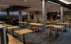 A variety of public health procedures, including designated clean and dirty tables, unidirectional routes, and socially-distanced seating protect students dining in Pioneer Hall on Monday, Nov. 2.