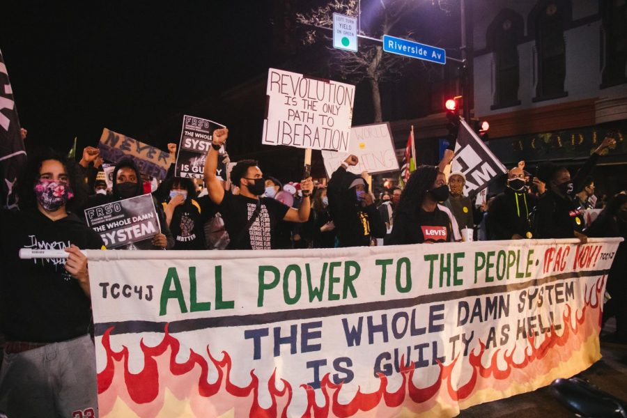 Protesters march on Cedar Ave. S. on Wednesday, Nov. 4. The rally was held to address a People's Mandate requesting action be taken to end racism, COVID-19 and the recession no matter who wins this year's presidential election.