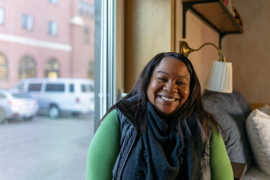 Rochelle Washington poses for a portrait in a tiny home outside Elm Church on Wednesday, Dec. 9.