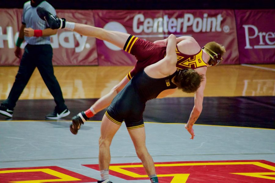 An Iowa State wrestler takes down Gopher Wrestler Boo Dryden in Maturi Pavilion on Friday, Jan. 22. The Gophers lost with a final score of 35-4.